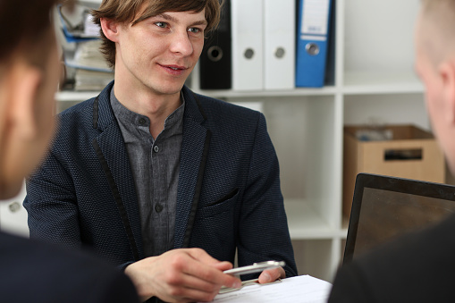 863148614 istock photo Handsome man in suit offer contract form on clipboard pad 801300216