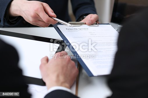 863148614istockphoto Handsome man in suit offer contract form on clipboard pad 846395182
