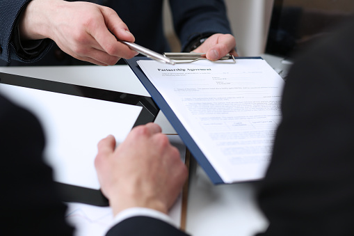 863148614 istock photo Handsome man in suit offer contract form on clipboard pad 846395182