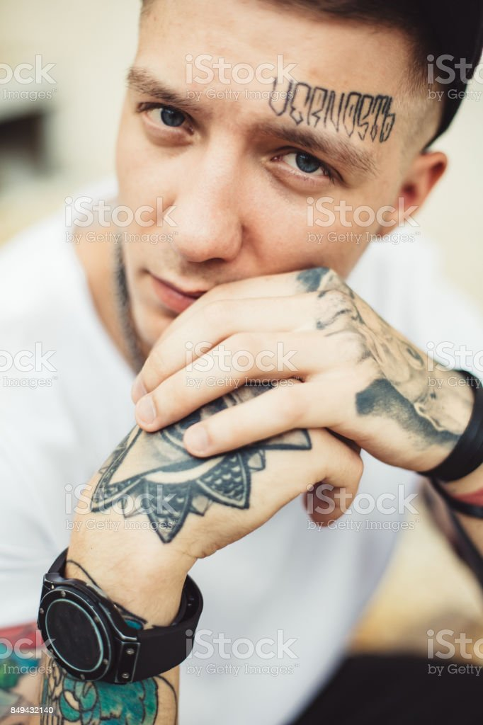 Handsome man in tattoos posing stock photo