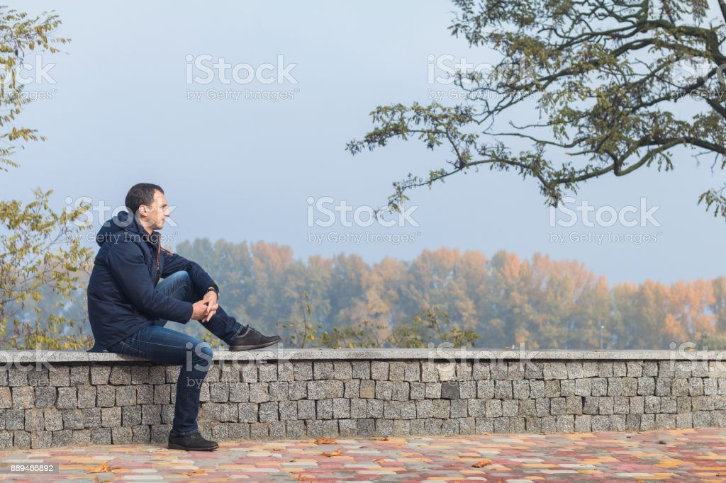 Handsome man in the autumn park royalty-free stock photo