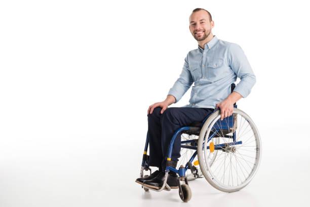 hombre guapo en silla de ruedas - wheelchair fotografías e imágenes de stock