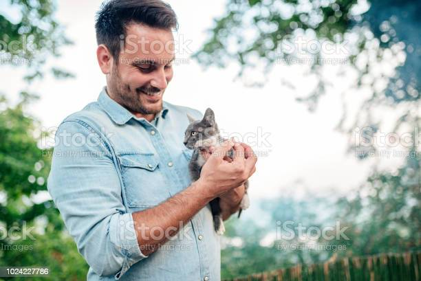 Handsome man is holding and hugging cute cat outdoors picture id1024227786?b=1&k=6&m=1024227786&s=612x612&h=7ypmkcxu ujlwooptgkhhuhklmwnemuvvivdrqqspk8=