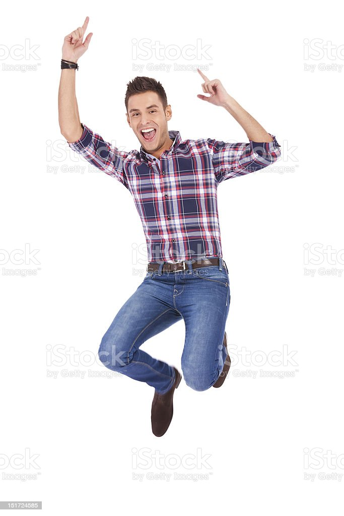 Handsome man jumping stock photo