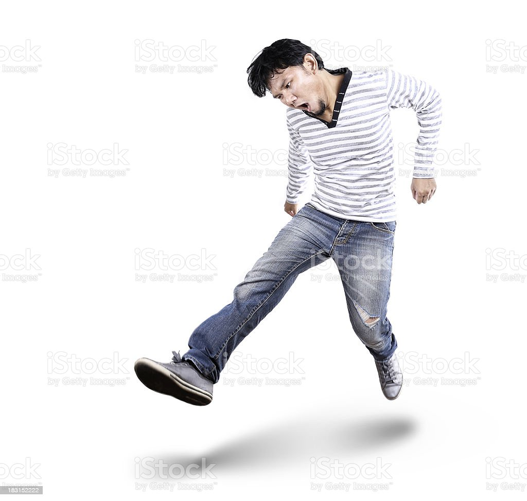 handsome man kicking royalty-free stock photo