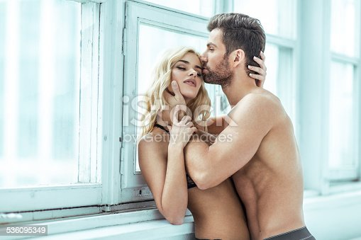 istock Handsome man kissing blond beauty 536095349