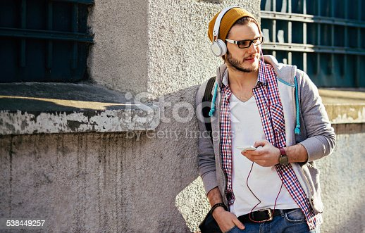 istock handsome man listening to music 538449257