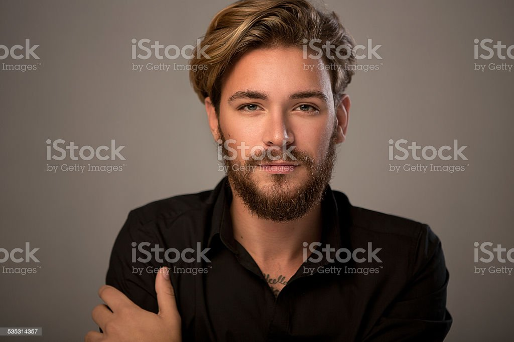 Handsome man looking at camera. stock photo
