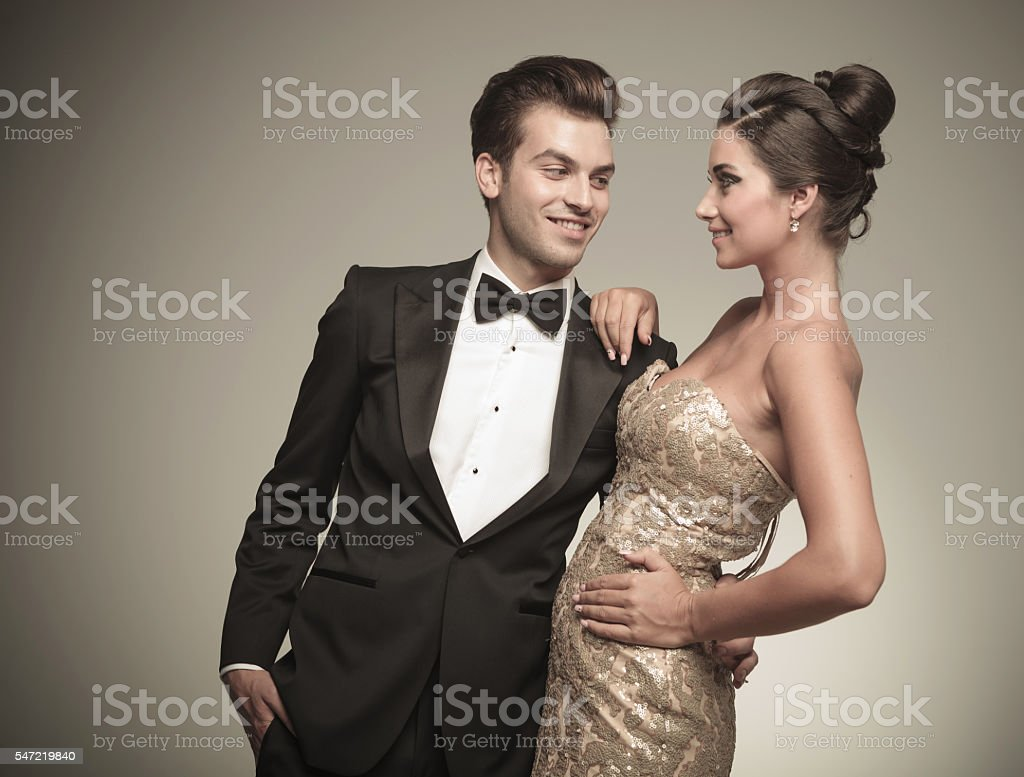 handsome man looking at his wife while embracing her. stock photo