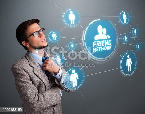 1190039622istockphoto Handsome man looking at modern social network 1209183189