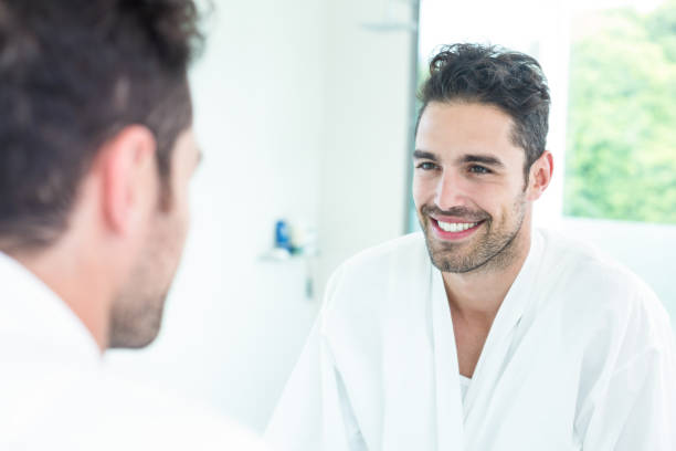royalty free man looking in mirror pictures images and stock photos