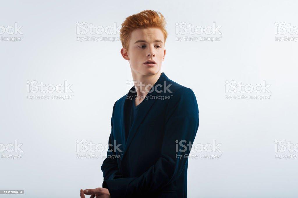 Handsome man looking over his shoulder stock photo
