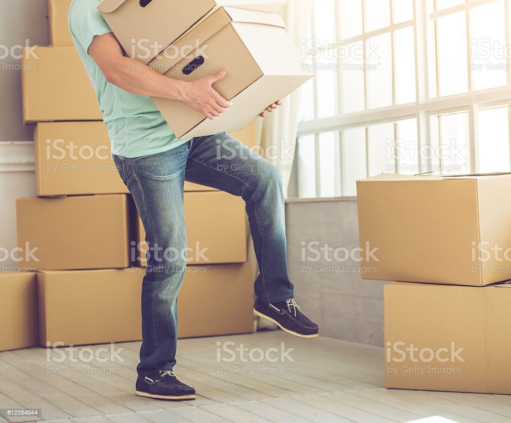 Handsome man moving stock photo