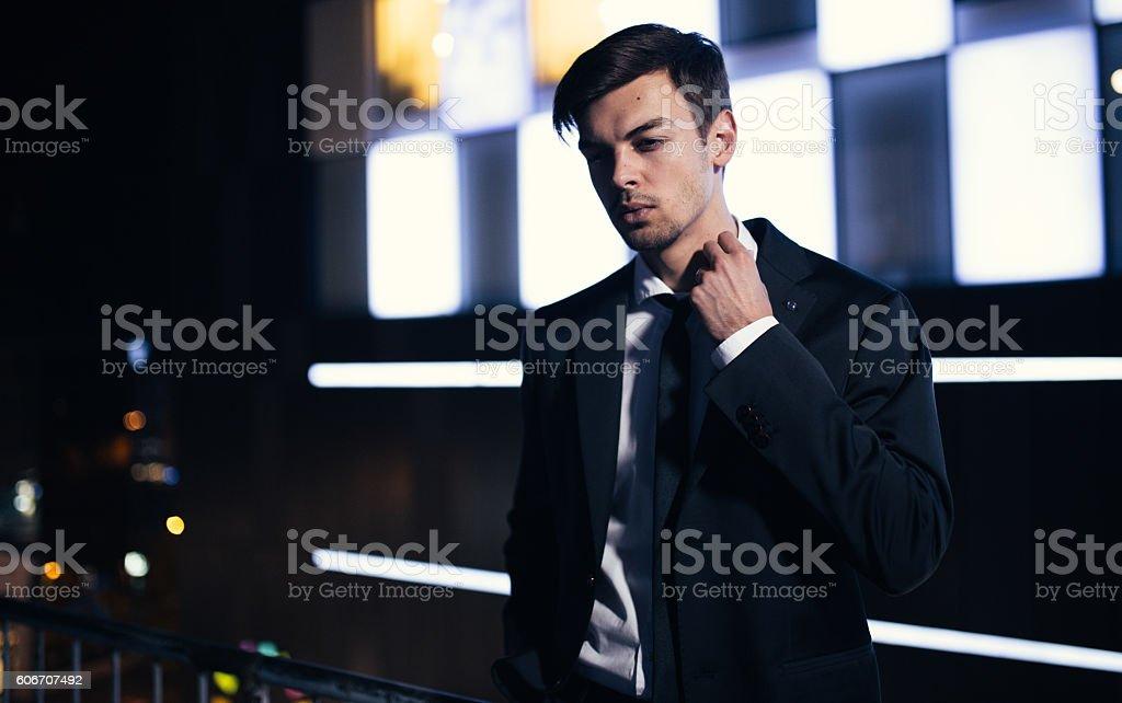 Handsome man on balcony - Photo