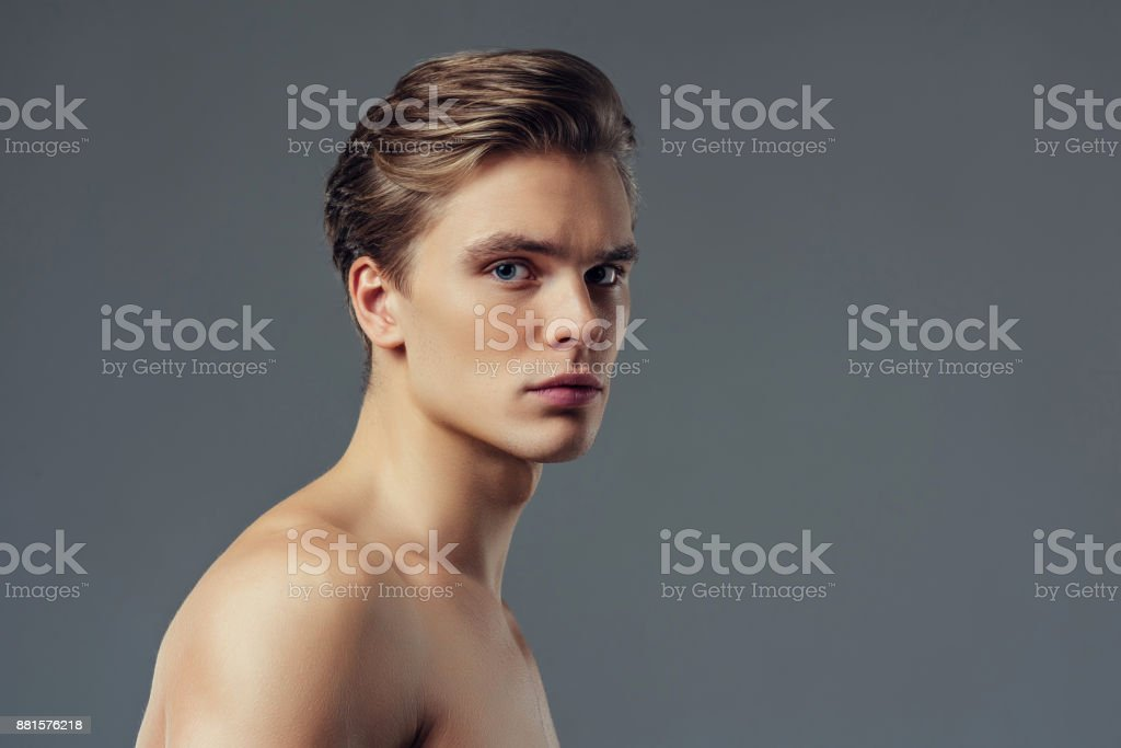 Handsome man on grey background. stock photo