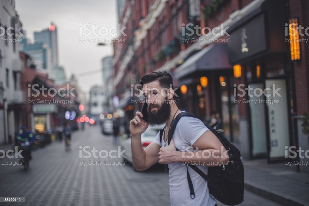 Handsome man on mobile stock photo