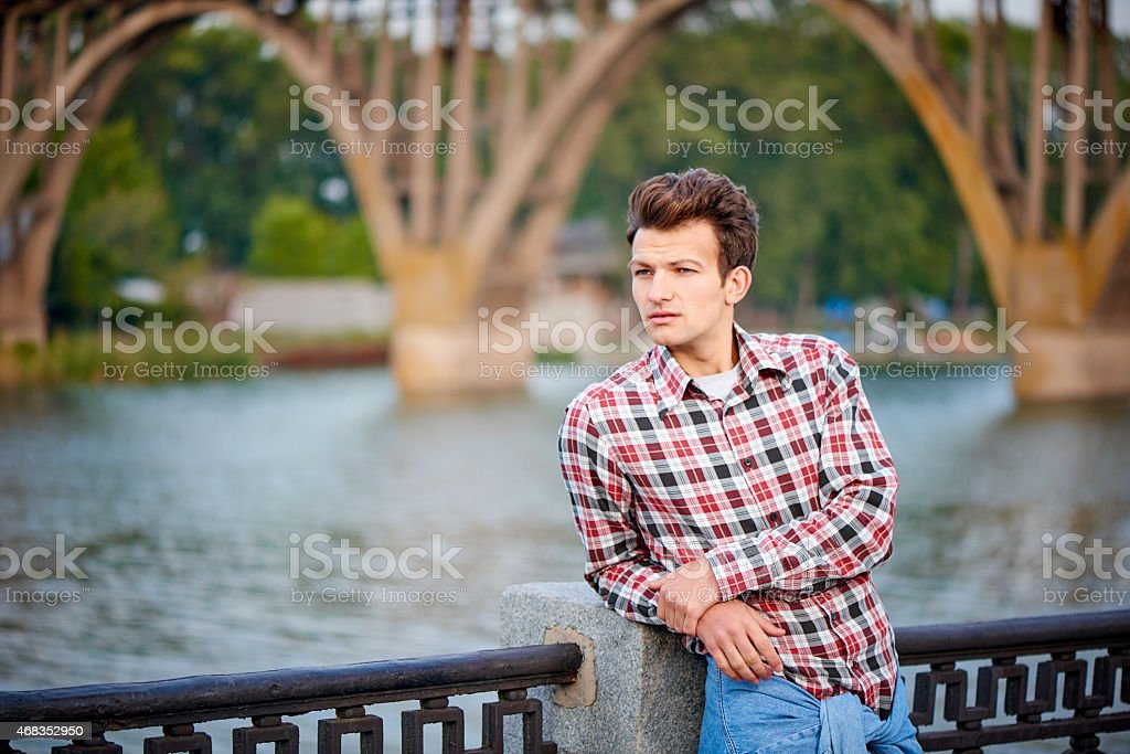 Handsome man outdoors over urban background royalty-free stock photo