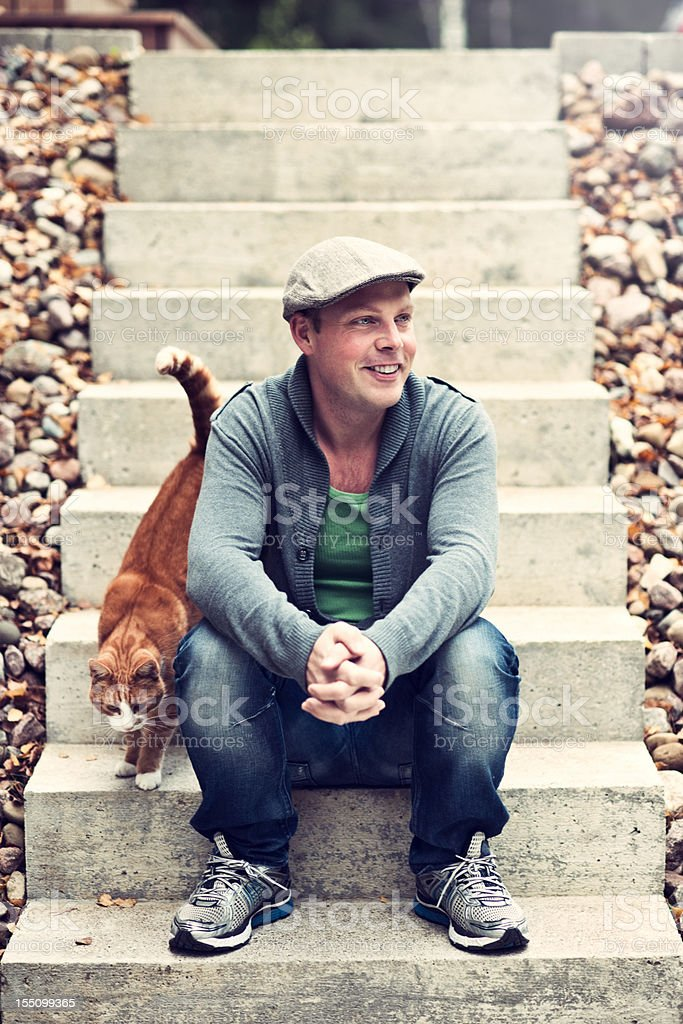 Handsome man outdoors with cat royalty-free stock photo
