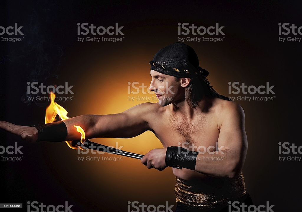 Handsome man performing fire show royalty-free stock photo