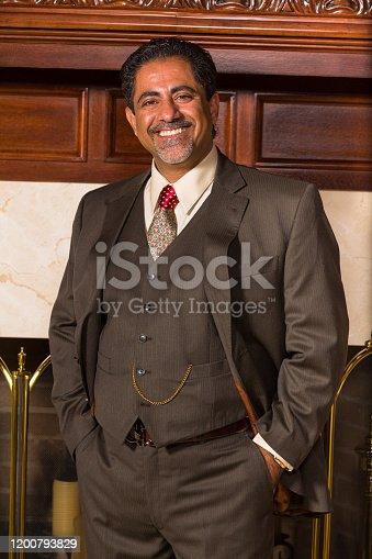 Handsome middle age middle eastern businessman portrait.