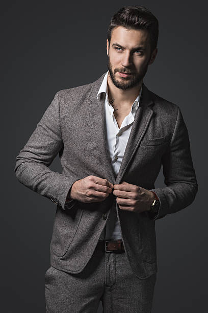handsome man - preppy fashion stock photos and pictures