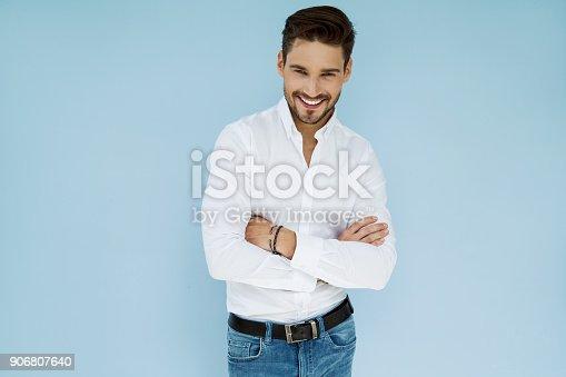 906807208 istock photo Handsome man 906807640