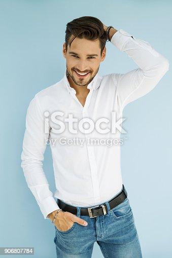 906807208 istock photo Handsome man 906807784