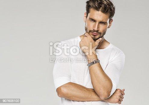 istock Handsome man 907605102
