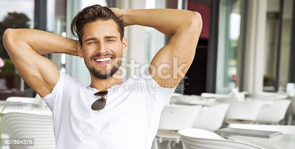 istock Handsome man 907884376