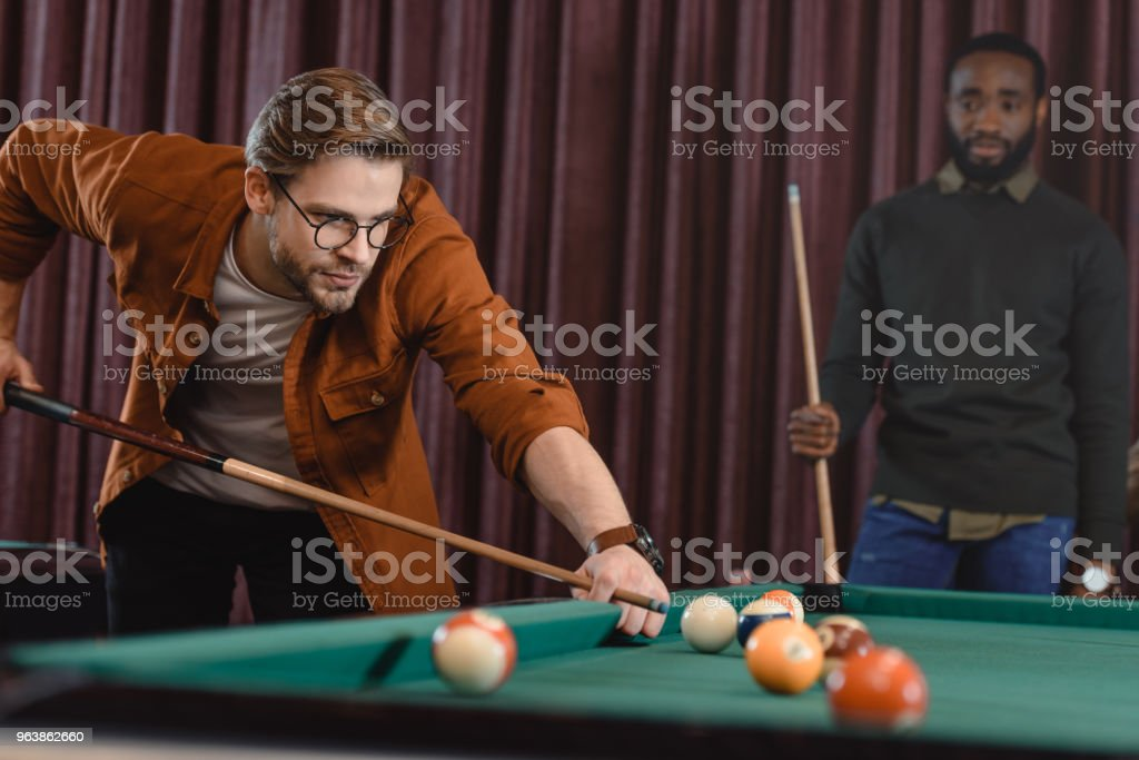 handsome man playing in pool at bar with friend - Royalty-free Adult Stock Photo
