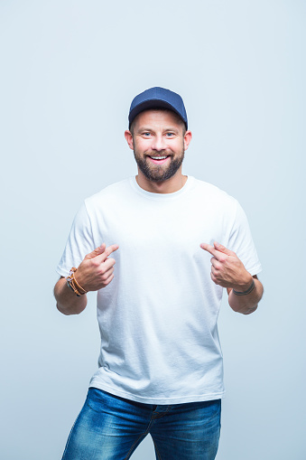 Handsome Man Pointing At Himself Stock Photo - Download Image Now