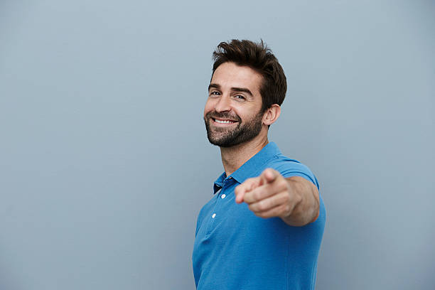 handsome man pointing - finger point stock photos and pictures