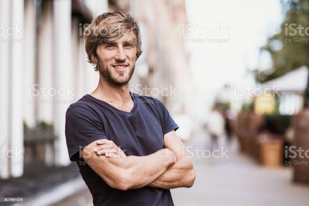 Handsome man portrait outdoors stock photo