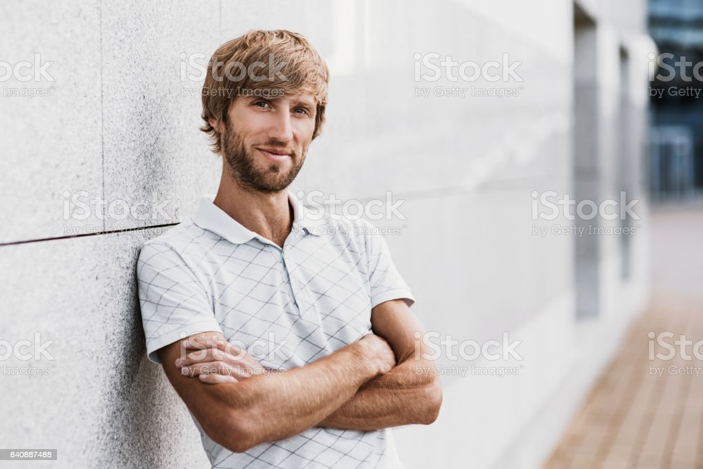 Handsome man portrait outdoors stock photo