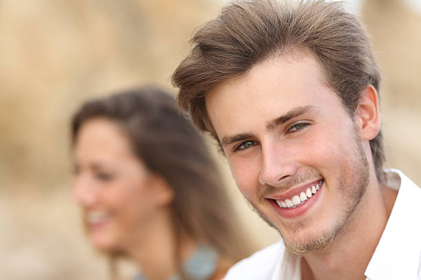 handsome man portrait with a perfect white tooth and smile - 異性情侶 個照片及圖片檔