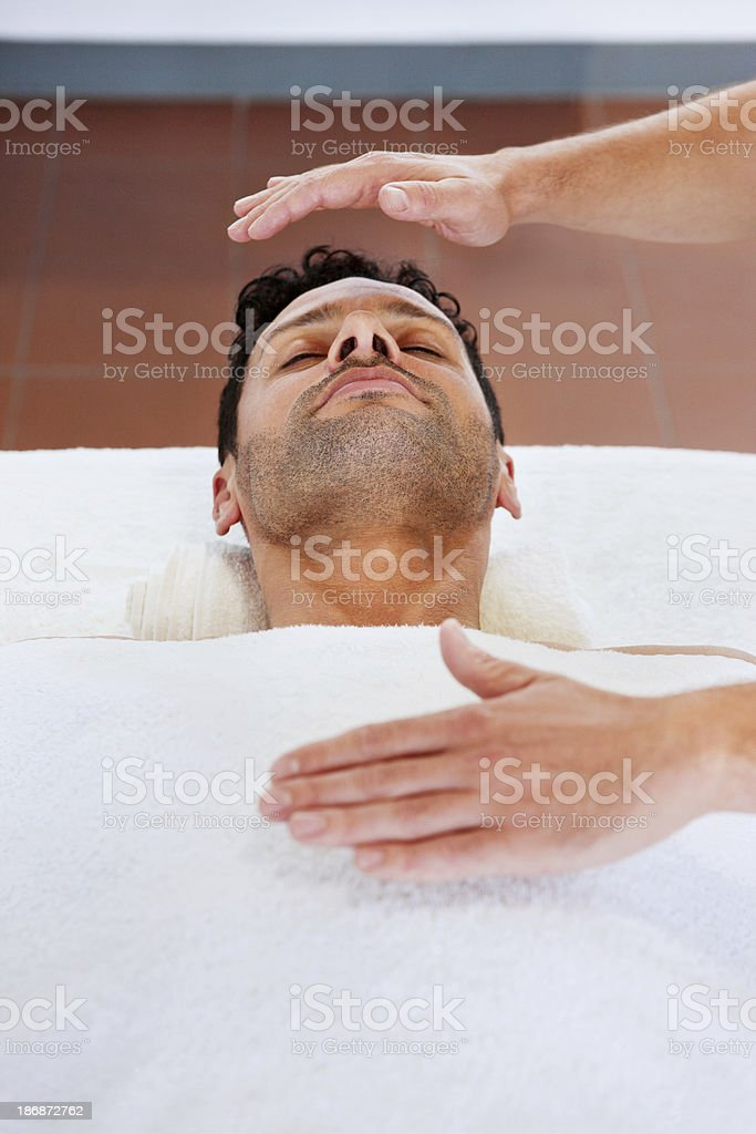 Handsome Man Receiving New Age Therapy royalty-free stock photo