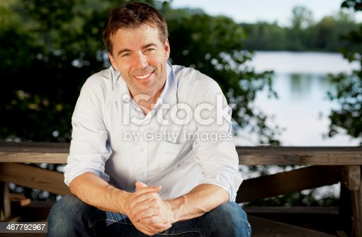istock Handsome man relaxing at the lake 467792967