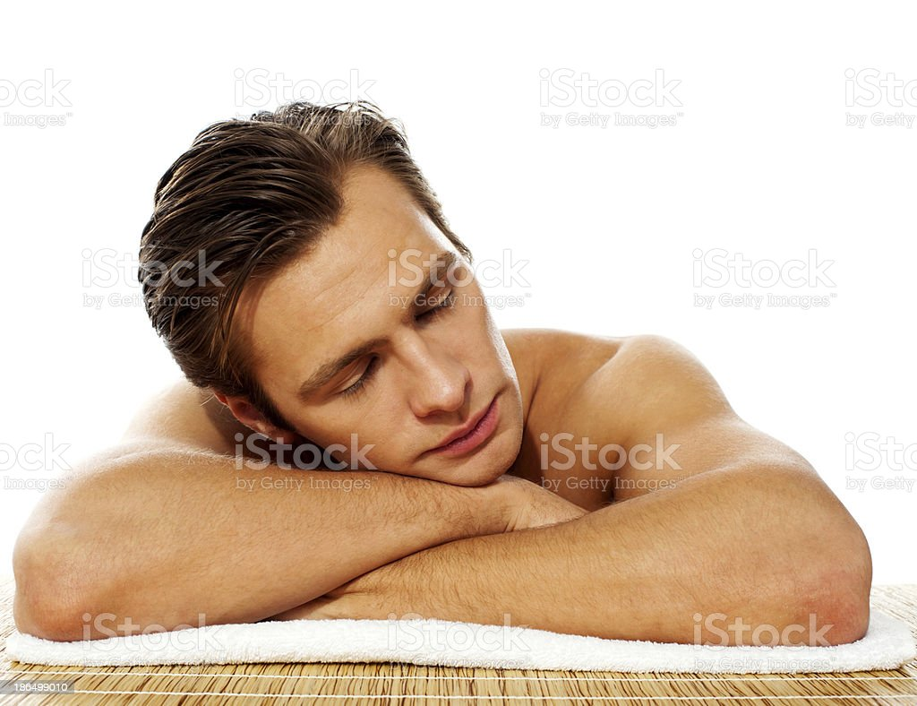 Handsome man relaxing before spa treatment royalty-free stock photo