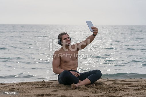 491496340 istock photo Handsome  man resting alone at the beach 679275916