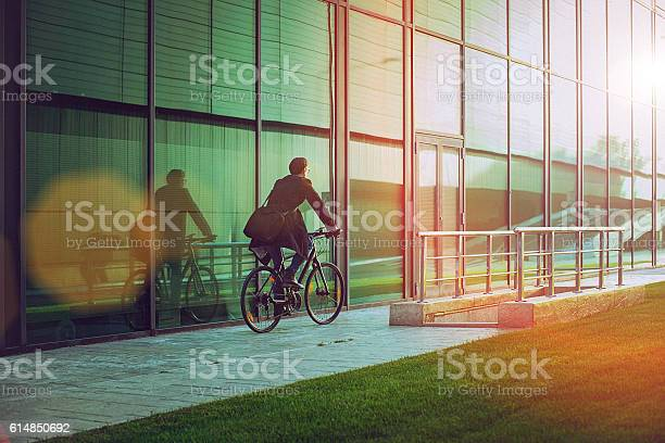 Handsome man riding bicycle beside the modern office building picture id614850692?b=1&k=6&m=614850692&s=612x612&h= wrqe85ovu6yjs3f8miaaaczmcop2y m13lrjd3huxc=
