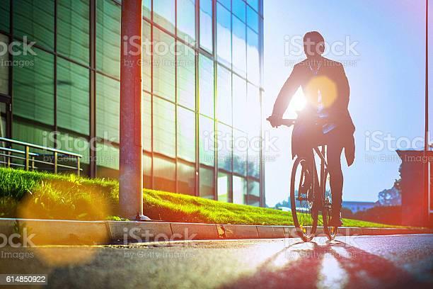 Handsome man riding bicycle beside the modern office building picture id614850922?b=1&k=6&m=614850922&s=612x612&h=4hfstqusodysgfcjcwsg5wntabpnt70bxs49y6hjrb8=