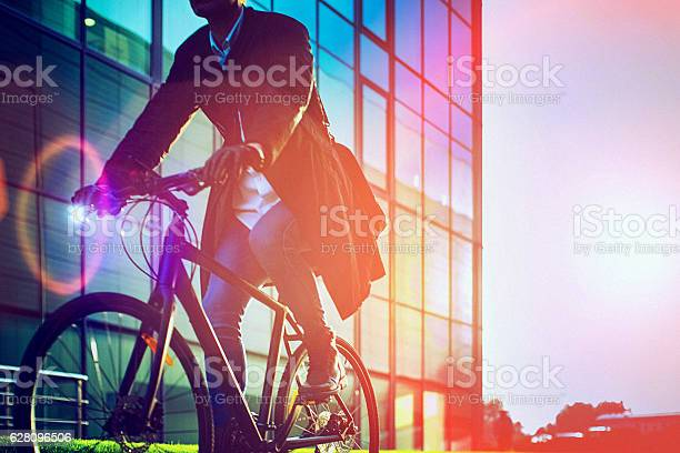 Handsome man riding bicycle beside the modern office building picture id628096506?b=1&k=6&m=628096506&s=612x612&h= xl6reyvoczxgbucuzpum1ree7mldwyw1mzjrwagb e=