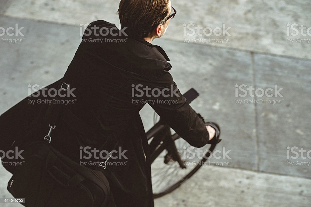 Handsome man riding bicycle in the city stock photo
