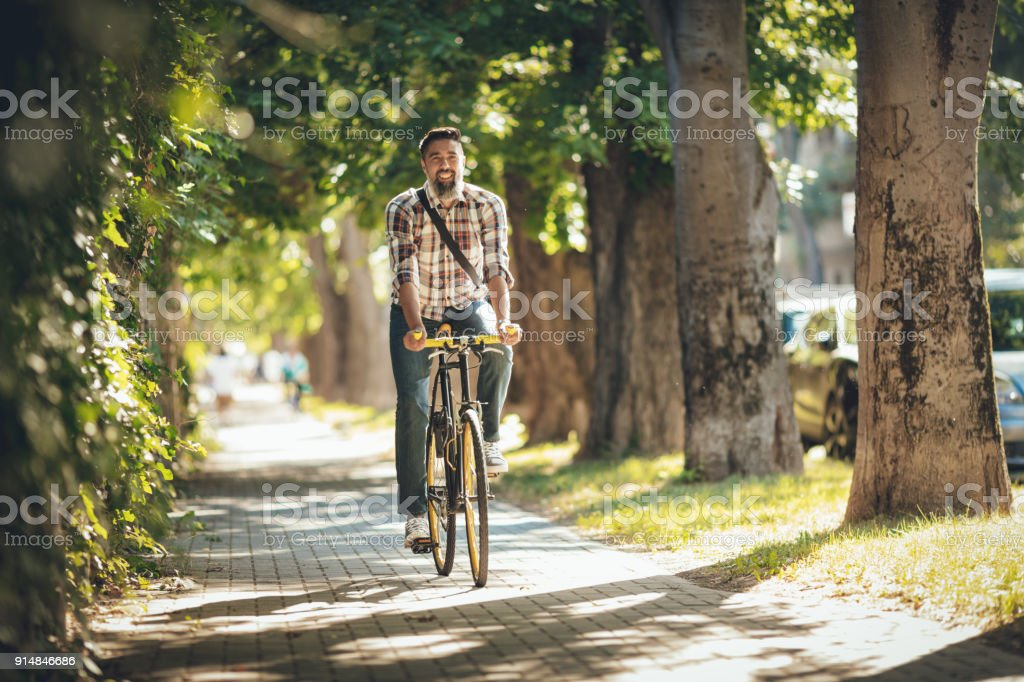 Handsome Man Riding Bicycle stock photo