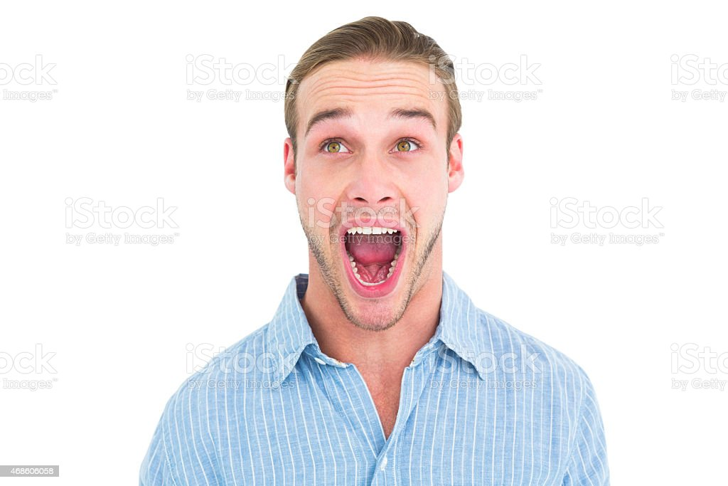 Handsome man screaming out loud stock photo