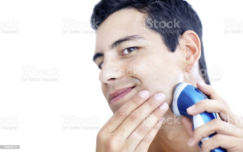 Handsome man shaving with electric shaver isolated on white stock photo