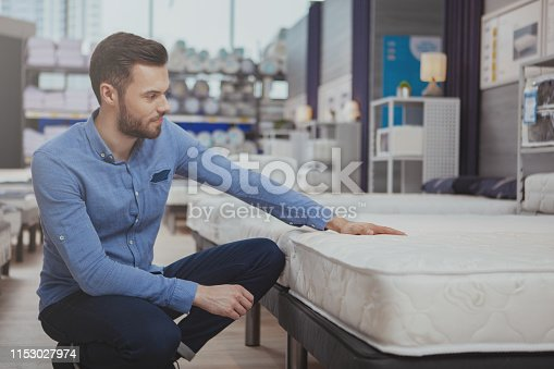 istock Handsome man shopping at furnishings store 1153027974