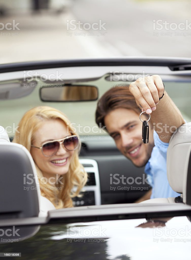handsome man showing car key royalty-free stock photo