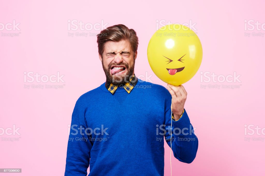 Handsome man showing feeling of disgust stock photo