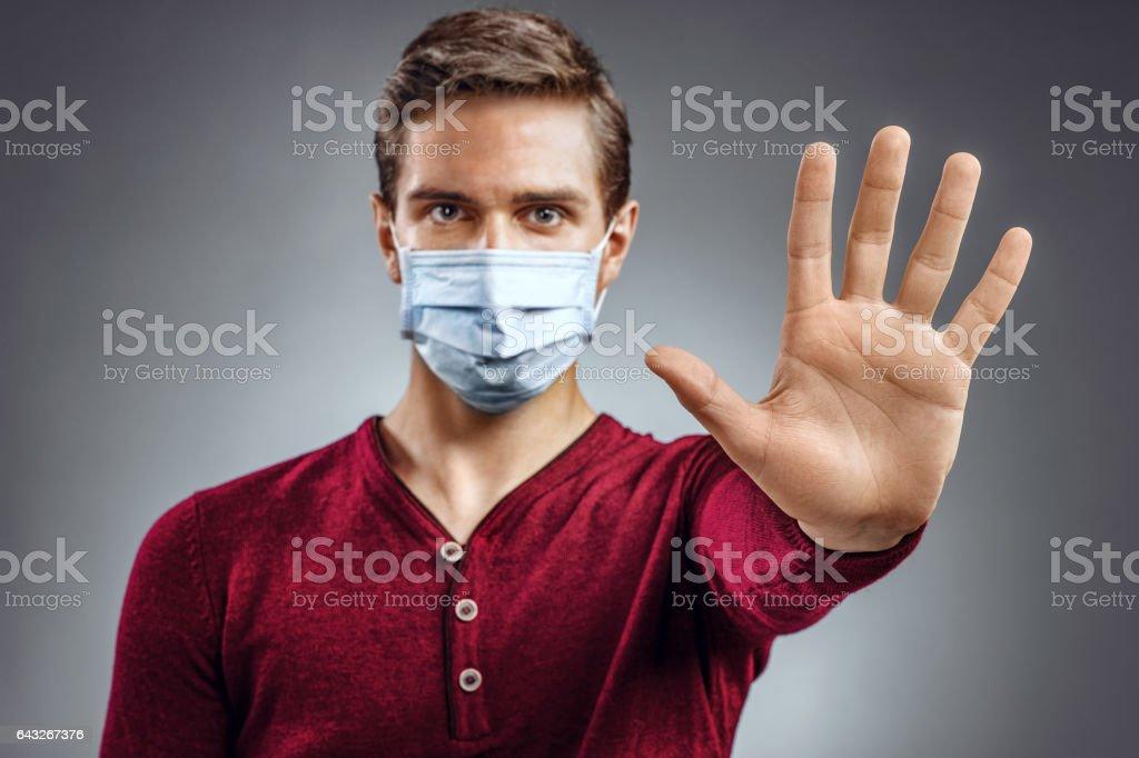 Handsome man showing gesture 'stop'. stock photo